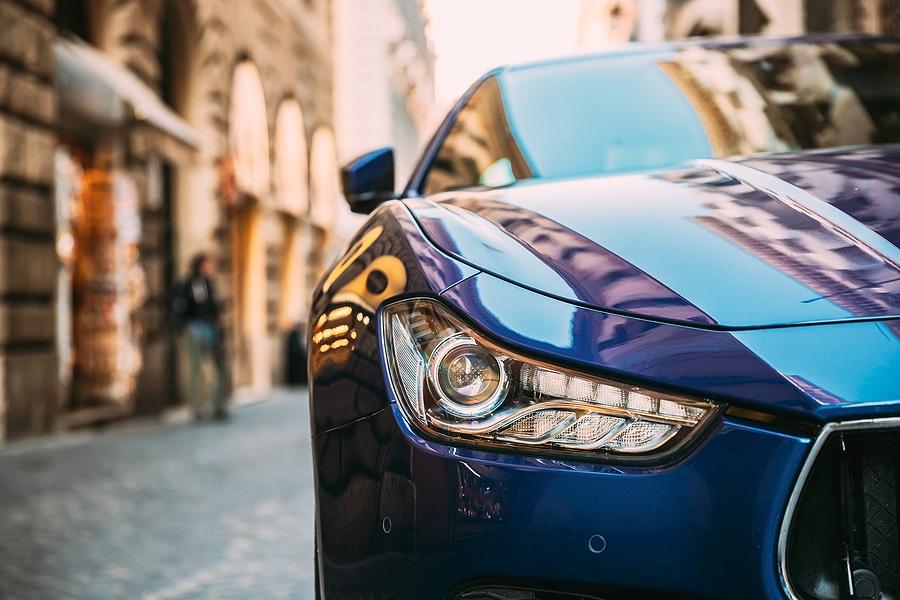 Close Up Headlight Of Blue Color Maserati Ghibli M157 Car Parked At Street